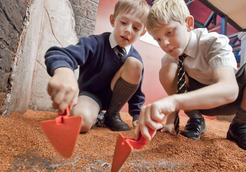 Children enjoying the digging pits at DIG